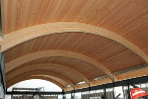 An example of heavy timber construction, using Douglas fir timber decking on top of curved glued-laminated (glulam) units.