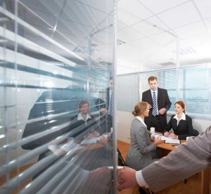 Sound-masking continues to provide acoustic control when a meeting room's door has been opened. Photo © iStockphoto/mediaphotos
