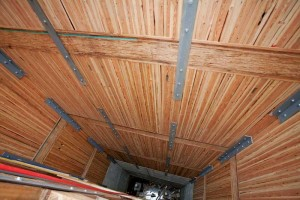 Incorporating a laminated 2x6 stud elevator shaft design into a mid-rise building is yet another way of minimizing the effect of differential movement that can be caused by the introduction of dissimilar building materials.