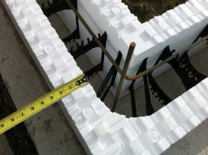 These R-30, 82.5-mm (3.25-in.) blocks were designed from the ground up as a thicker system. The full-width mating surfaces on top and bottom can make the blocks easier and faster to align. Webs are embedded more deeply than in thinner blocks, increasing the strength of the form to hold wet concrete loads and reducing the likelihood of blow-outs. This image also shows clearly how webs provide a reliable way to position and secure steel reinforcing bars in the structural concrete wall.