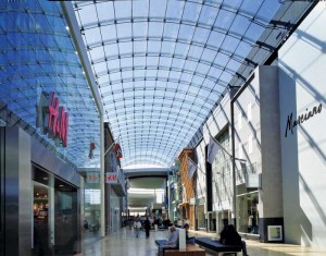 A renovated minimally supported, barrel-vaulted laminated glass skylight at Toronto's Yorkdale Shopping Centre capitalizes on natural light to brighten the mall's interior. Photo courtesy W&W Glass