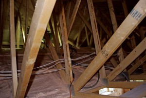 Closed-cell sprayed polyurethane foam (ccSPF) forms both an air and vapour barrier in this attic. To save cost, the final R-value can be achieved with an additional layer of blown-in insulation. Photos courtesy Kinlar