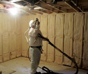 Sprayfoam insulation being applied to a basement. It expands to fill complex shapes in basement headers.