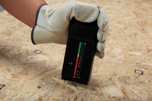 A moisture meter is necessary to confirm a subfloor is adequately dry before hardwood flooring is installed.