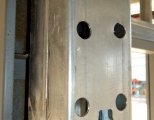 Pre-assembled built-up jamb studs are difficult to connect to a pre-assembled hollow metal frame (HMF). One workaround is to cut holes through one side of the stud to screw through the interior of the opposite side into the HMF. This can be difficult to inspect and may cause delays.