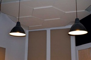 Whether a recording studio or a conference room, honeycomb-shaped acoustic ceiling clouds prevent reflection and control reverb in a space with high ceilings.