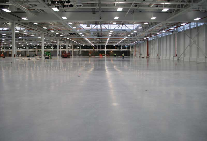Four ways to eliminate joints in wide slab concrete floors for Slab on grade ontario