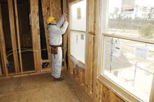 A sprayed polyurethane foam (SPF) contractor prepares a home before application.
