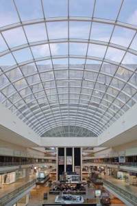 A clear anodize finish on an aluminum skylight systems enhances the durability and longevity of a shopping centre's skylight system in a storm-prone region. This finish meets rigorous testing performance standards including 3000 hours of salt-spray resistance. Unlike other finishes, as an integral part of the substrate, anodizing highlights aluminum's metallic appearance. Photo © William Lemke. Photo courtesy Super Sky Products