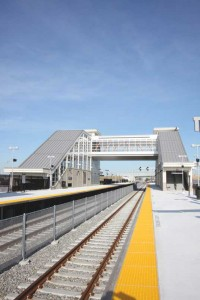 The new train station at the Meadowlands Sports Complex in East Rutherford, N.J., allows the complex to serve sports fans from New York and New Jersey and to accommodate future growth in the region. The project features cool metal roofing for the central station and platform canopy. The slate gray material protects passengers and is highly visible from all directions around the facility and the adjacent New York Giants Stadium. Photo courtesy Englert Inc.