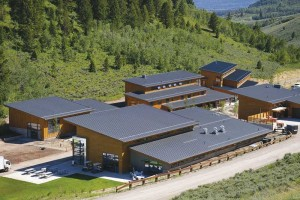 The Jackson, Wyo., campus of the Teton Science Schools, was designed for low impact on the environment. Metal was chosen for the roof and some walls based on lifecycle costs, low maintenance, and appearance. The campus sits on the edge of a national forest so the high level of fire protection provided by the metal roofing was also important. Photo courtesy MBCI