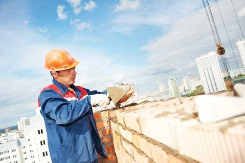 bigstock-construction-mason-worker-bric-88666685