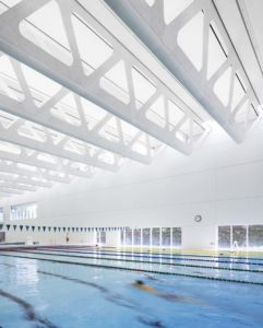 The ceiling was chosen for its numerous natatorium-friendly qualities, including resistance to mould, high reflectivity, acoustic attributes, and resilience in the presence of moisture.