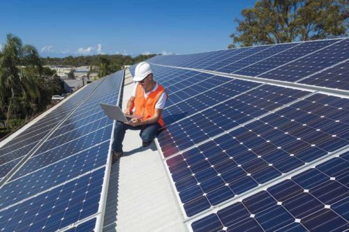 bigstock-solar-panel-technician-69564670