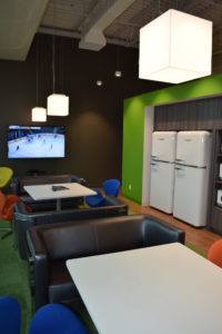 Colour, kitchen functionality, and rest space all play a role in creating an effective break room. Stantec's Waterloo office utilizes all three. Image courtesy Stantec