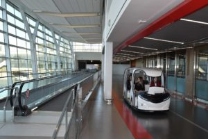 The new facility features sloped floors and ramps, vertical separations, and a call-to-gate system to streamline and organize passenger travel through the space. Photo courtesy YYC Calgary Airport Authority