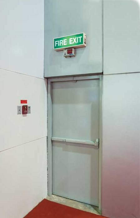 bigstock-fire-exit-door-104591699