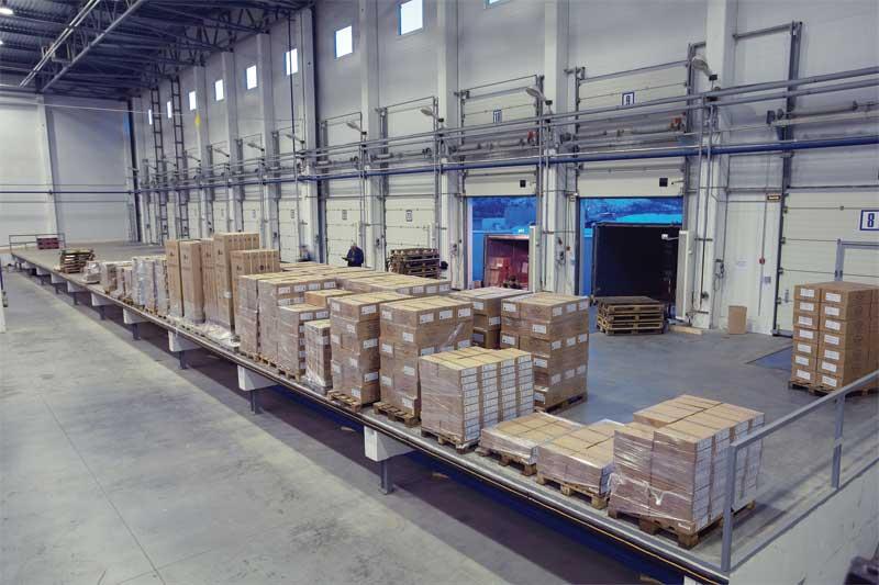 bigstock-unloading-system-inside-wareh-76195004