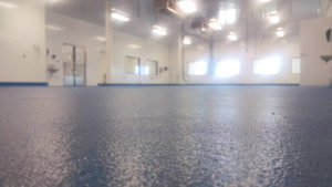 Food and beverage facility with a urethane cement floor coating.