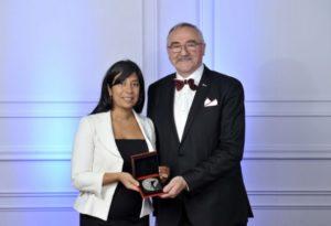 Kathy Baig, FEC, president of the Ordre des ingénieurs du Québec presents the 2018 Grand Prix d'excellence award to Roland Charneux, P.Eng., LEED AP BD+C, director at Pageau Morel. Photo courtesy Pageau Morel