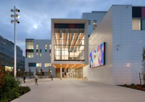 Recessed slotlights in soffits provide strong illumination at building entries and align with interior slotlights at Emily Carr University of Arts and Design in Vancouver. The project has won the 2018 Vision Award from the Illuminating Engineering Society of British Columbia. Photo © Silent Sama