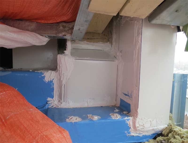 After: Sheet metal (shown in white) and sealant can be an option to address such complex tie-in details. Care must be taken when using metal to prevent new issues such as thermal bridging.