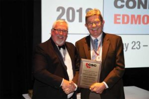 CSC president David Boyle, CTR, presents John G. Cooke, FCSC, RSW, with a CSC Life Award.
