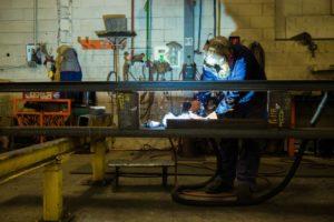 Welder in a steel fabrication shop.