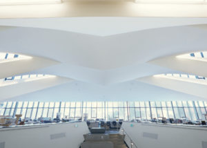 Designed to replicate wings, the angled drywall ceiling slabs gently twist from one side of the space to the other.