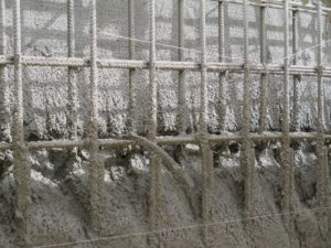 In this image, voids are forming behind rebar during shotcrete application. Photo courtesy GCP Applied Technologies