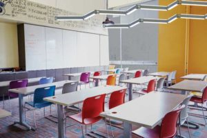 Direct/indirect pendants like these can be separately switched to allow teachers to control when direct light is emitted onto the desks or when indirect light alone softly illuminates the ceiling.