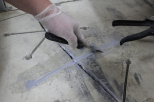 A carbon fibre overlay stops cracks by locking in both sides of a crack, preventing further movement. It is designed to structurally repair cracks in concrete floors, decks, and foundations. Installation can be completed in minutes using only a diamond blade and drill. The ultra-thin profile uses less epoxy, making it cost effective and less intrusive.