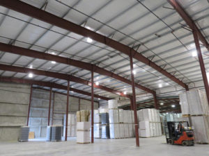 The Okanagan Spirits Craft Distillery has added a new 1553-m2 (16,720-sf) custom built pre-engineered steel building to its existing storage facility in Vernon, British Columbia. Image courtesy Metal Structure Concepts