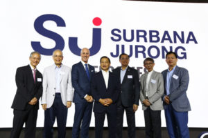 Bill Nankivell, CEO of B+H Architects (third from left), along with Surbana Jurong's board members at the partnership announcement. Photo courtesy B+H