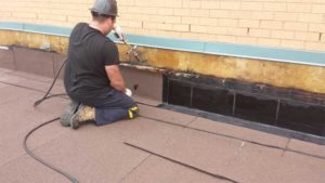 An office building in Mississauga, Ont., receives a new thermally fused application of modified bitumen (mod-bit) in a protected membrane roof (PMR).
