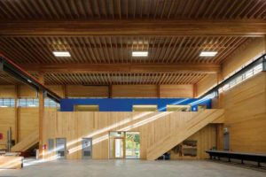 Abundant daylight and exposed wood finishes give the interior of a prefabrication factory near Whistler, B.C., a warm and inviting quality.