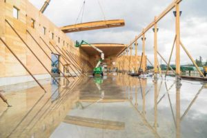 Roof panels span between exterior walls and the central glued-laminated (glulam) timber beam at this fabrication plant located in Abbotsford, B.C.