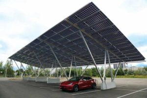 Solar carports offer shade and snow protection for vehicles and electricity generation for the building. Electric vehicle (EV) chargers can be integrated as an additional tenant benefit.