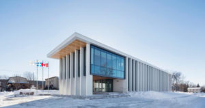 Rigaud City Hall, a new civic administration facility for a small Québec community, connects existing public amenities with new facilities, and redevelops several vacant lots. Photo © Adrien Williams