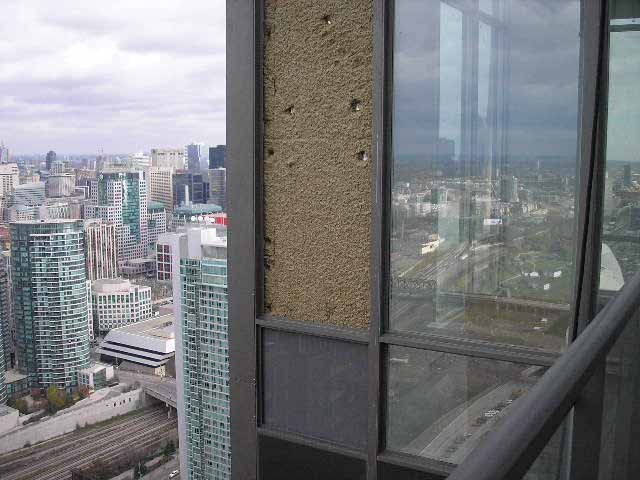 Example of acoustical insulation at window spandrel panel.