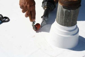 Prefabricated thermoplastic olefin (TPO) and polyvinyl chloride (PVC) accessories like the pipe boot shown here continue to be a boon to roofing contractors. If non-preformed flashings are used and become stiff in colder climates, the contractor will have a more difficult time completing details. Photo courtesy GAF