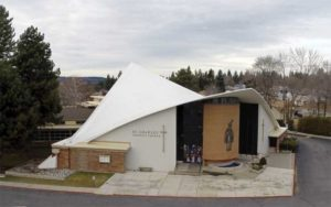 The reroofing of the St. Charles Parish and School in Spokane, Washington, with a reinforced, 1.5-mm (60-mil) TPO membrane preserves an important era in the evolution of modern architecture, featuring an irregularly shaped roof. Photo courtesy St. Charles Parish & School