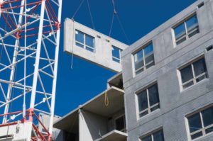 Installation of precast concrete wall panels.