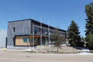 The main exterior finish of Alberta's Valleyview Town Hall is phenolic panel siding on the visible south and east elevations and prefinished metal siding on the north elevation. The south elevation is shown here.