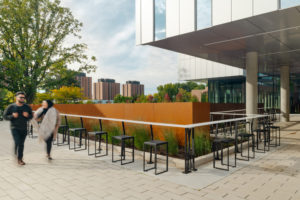 Cafe-style bar seating was introduced in the east entrance plaza of the new student centre with shaded areas for laptop users to take shelter from the sun's glare.