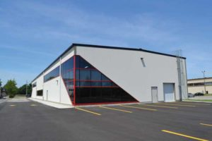 The new 1207-m2 (13,000-sf) Brantford Gymnastics Academy building in Ontario, nearly double the size of the previous gym, used a standing-seam steel roof system composed of steel single-skin panels. This choice of roofing system provided a high degree of weathertightness for the building envelope.