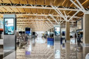 The acoustic ceiling design of the international terminal at the YYC Calgary International Airport features variety of ceiling surfaces such as modular, perforated aluminum panels, and lightweight wood, all of which mitigates noise and offers a look that is distinctly 'Calgary.' Photos © Jeffrey Totaro