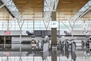 The wood ceiling above the ticketing area at the international terminal at the Calgary airport is a high-performance acoustic surface with a warm esthetic.