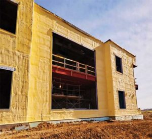 Closed-cell spray foam insulation acts as an all-in-one air, water, and vapour barrier for the exterior wall.