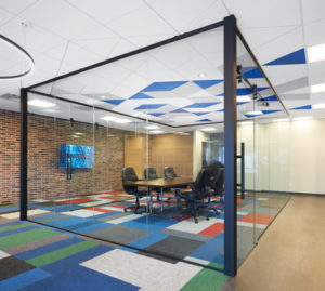 DESIGNFlex ceilings from Armstrong add colour to the glass-enclosed Max Games boardroom.